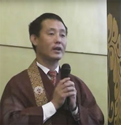 Rev. Sonam Bhutia with mic (video capture)