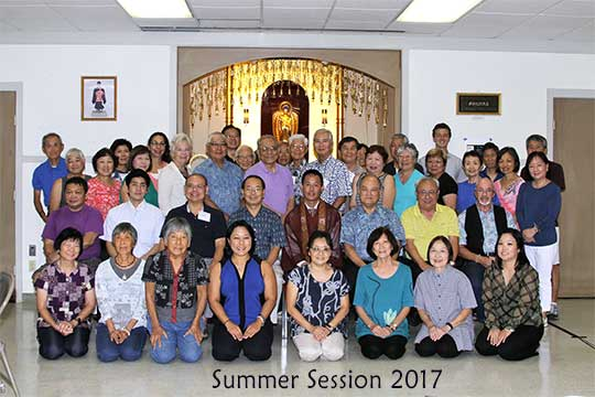 group of Summer Session attendees before the altar at BSC (2017 photo)